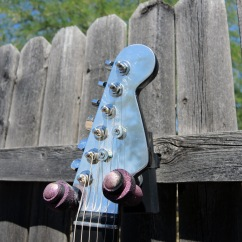 Fender-style head stock covered in aluminum